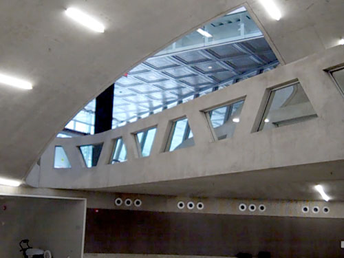 Milstein Hall's entry-bridge mezzanine, pictured above, is open not only to the floor below, but also to the floor above (photo by J. Ochshorn)